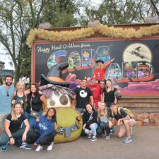Employees in front of a Cars Land sign at Disneyland