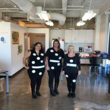 Three employees dressed up for a party